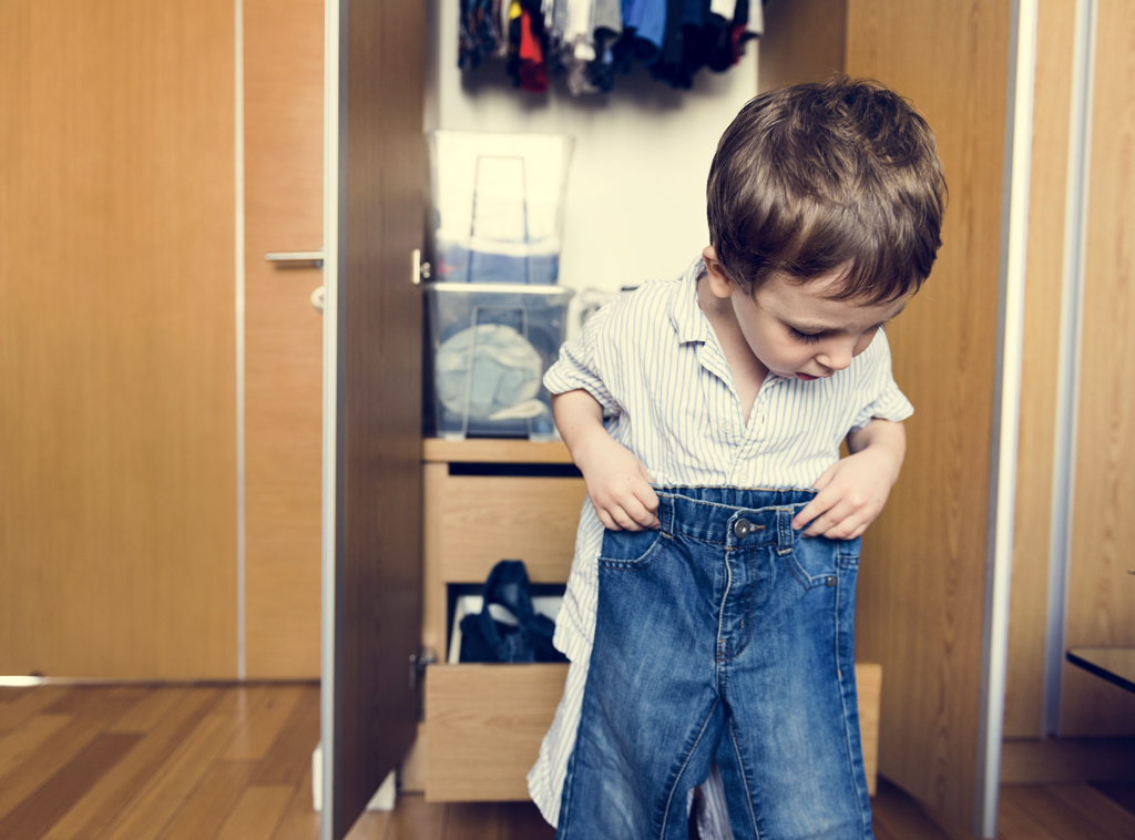 Child getting dressed by himself